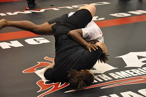 Lourdes Serrano of Team Third Law BJJ from Naples, FL hits a bump sweep in her first competition match ever at NAGA
