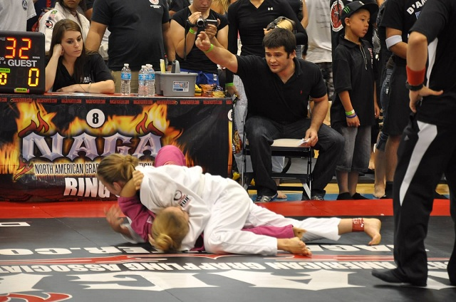 Rachel Ranschau, who trains in Naples in the Third Law BJJ Teens class, pins her opponent in side control after sweeping with an ommaplata sweep. She won this match for gold.